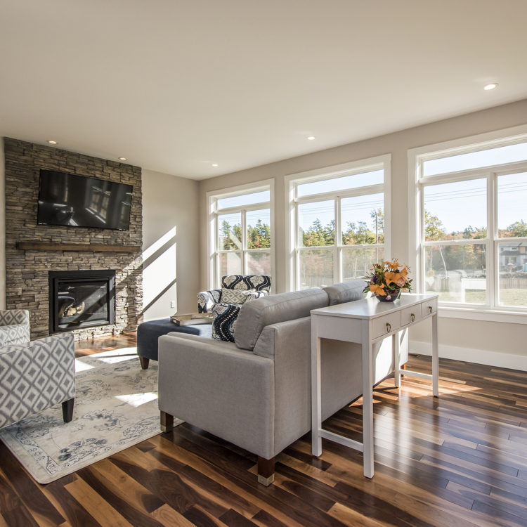 3 Sets of double hung windows in a living room
