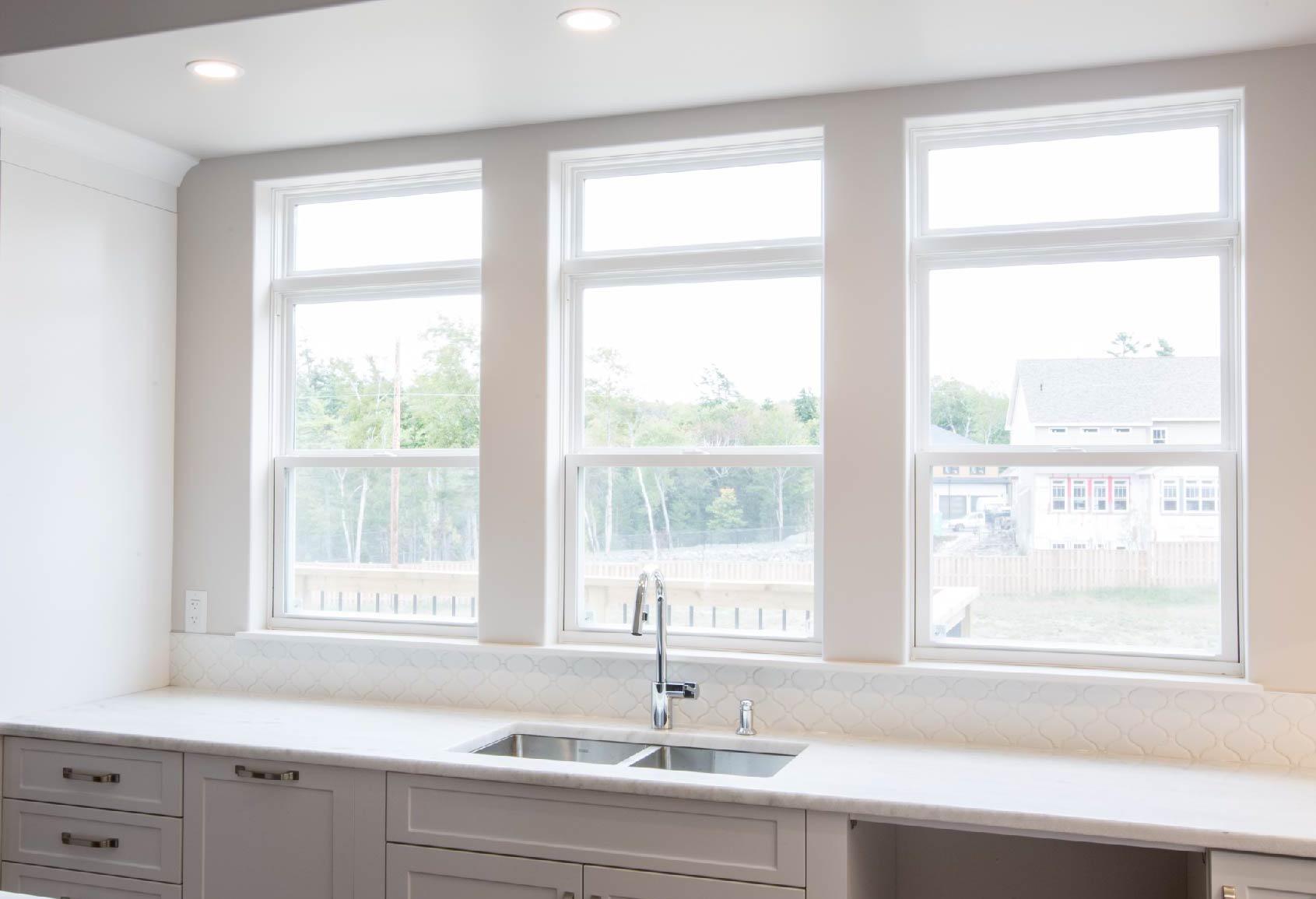 three single hung windows in beautiful open kitchen
