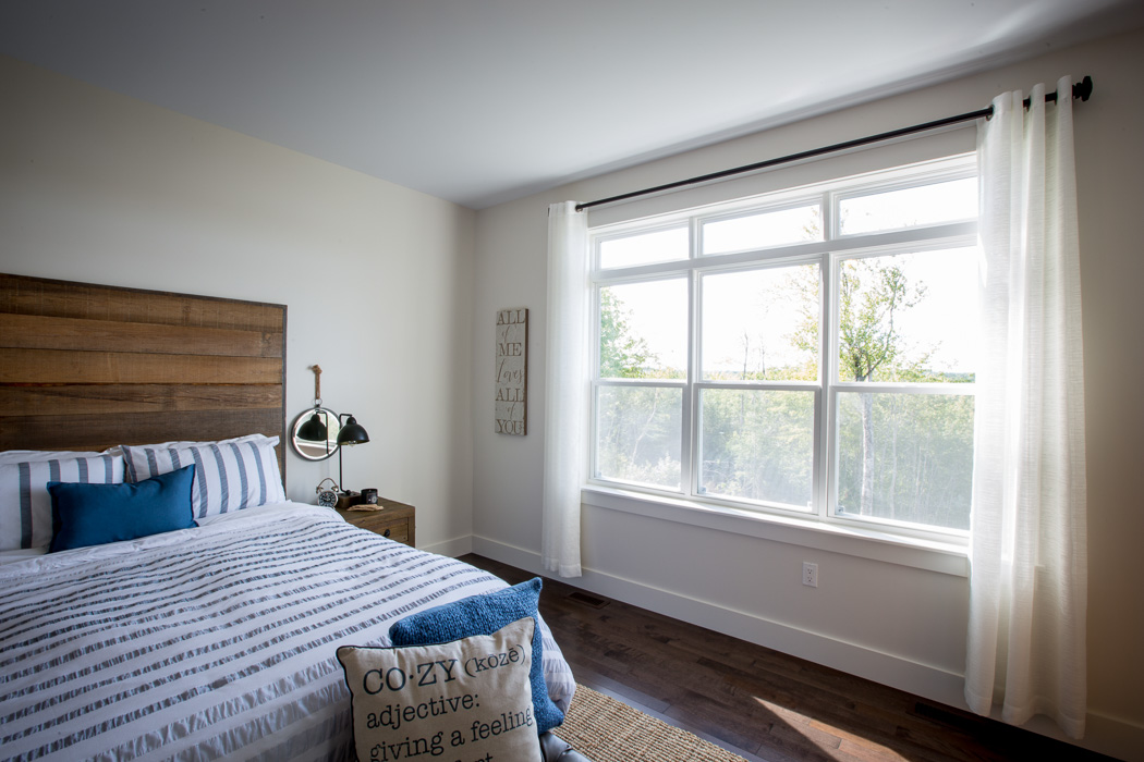 3 single hung windows in a bedroom