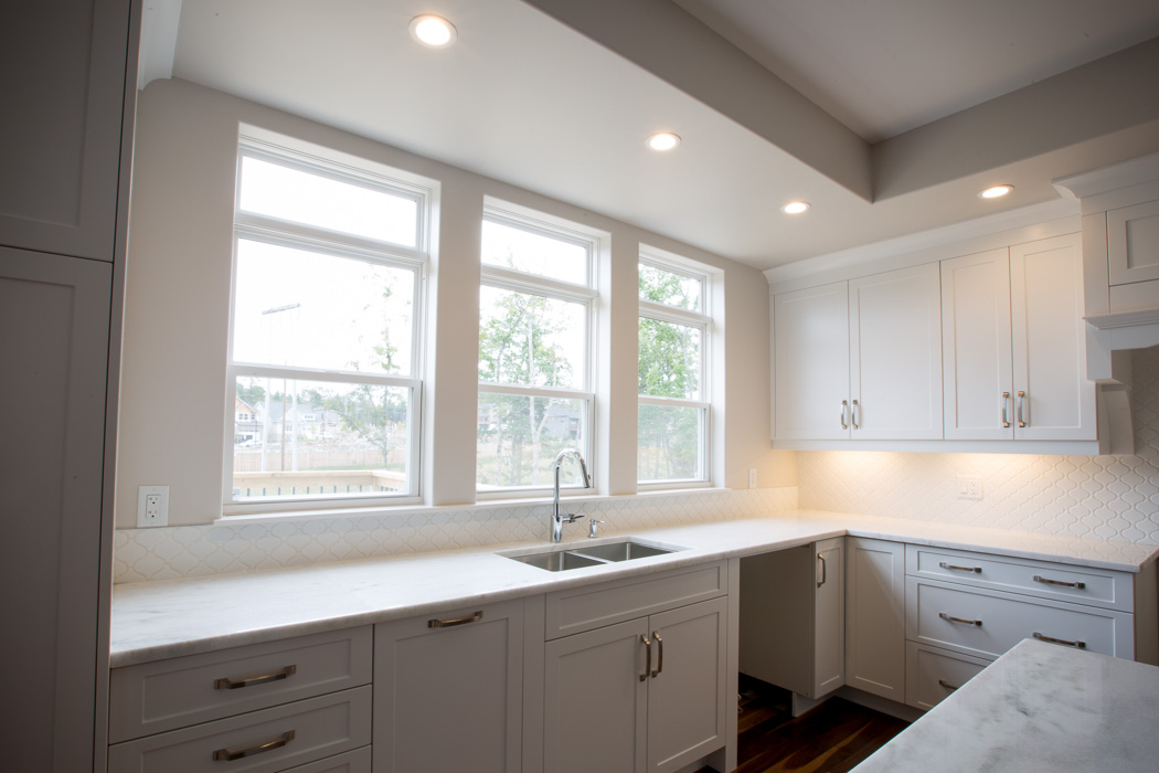 Kohltech double hung windows over sink in kitchen