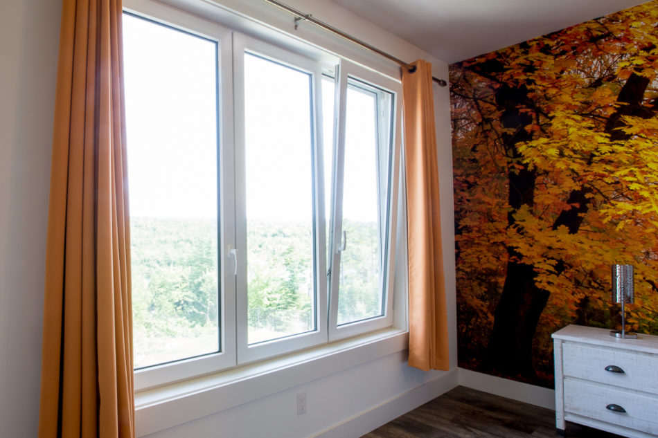3-Panel Tilt & Turn window in bedroom with orange curtains
