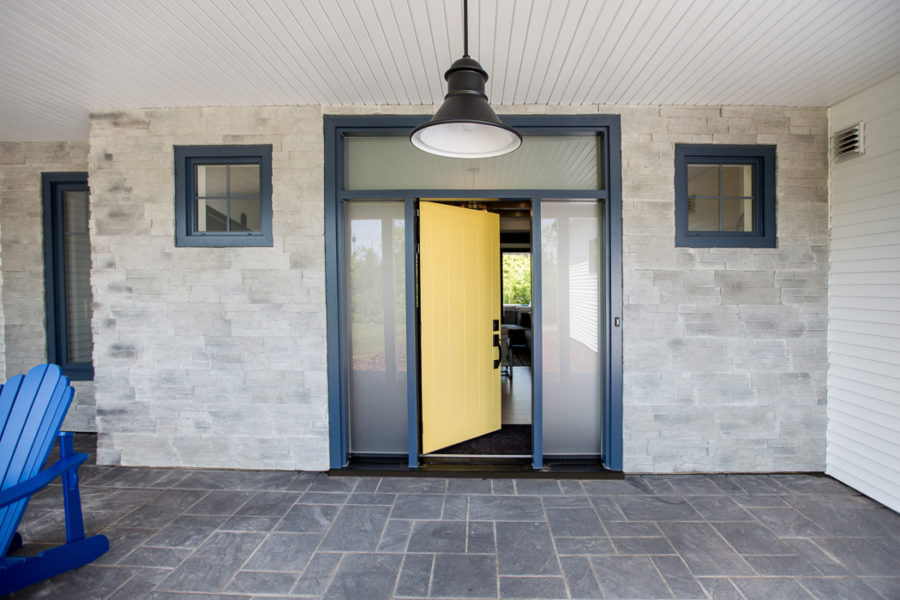 A Painted yellow door surrounded by dark blue transoms